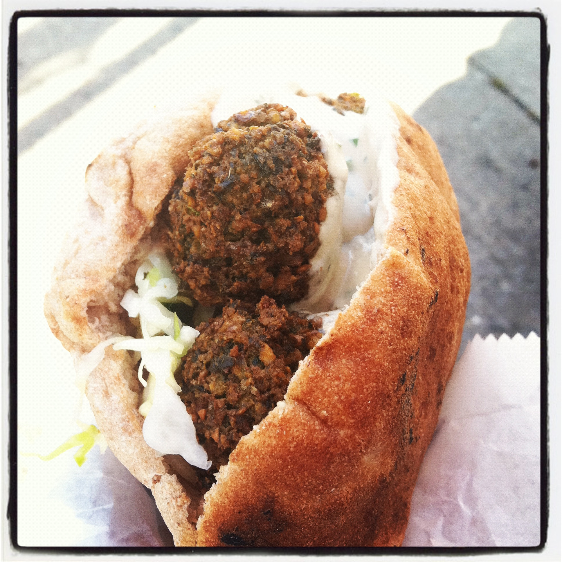 Falafel Sandwich: choose one falafel flavor, with hummus, israeli salad, pickled cabbage and tahini sauce