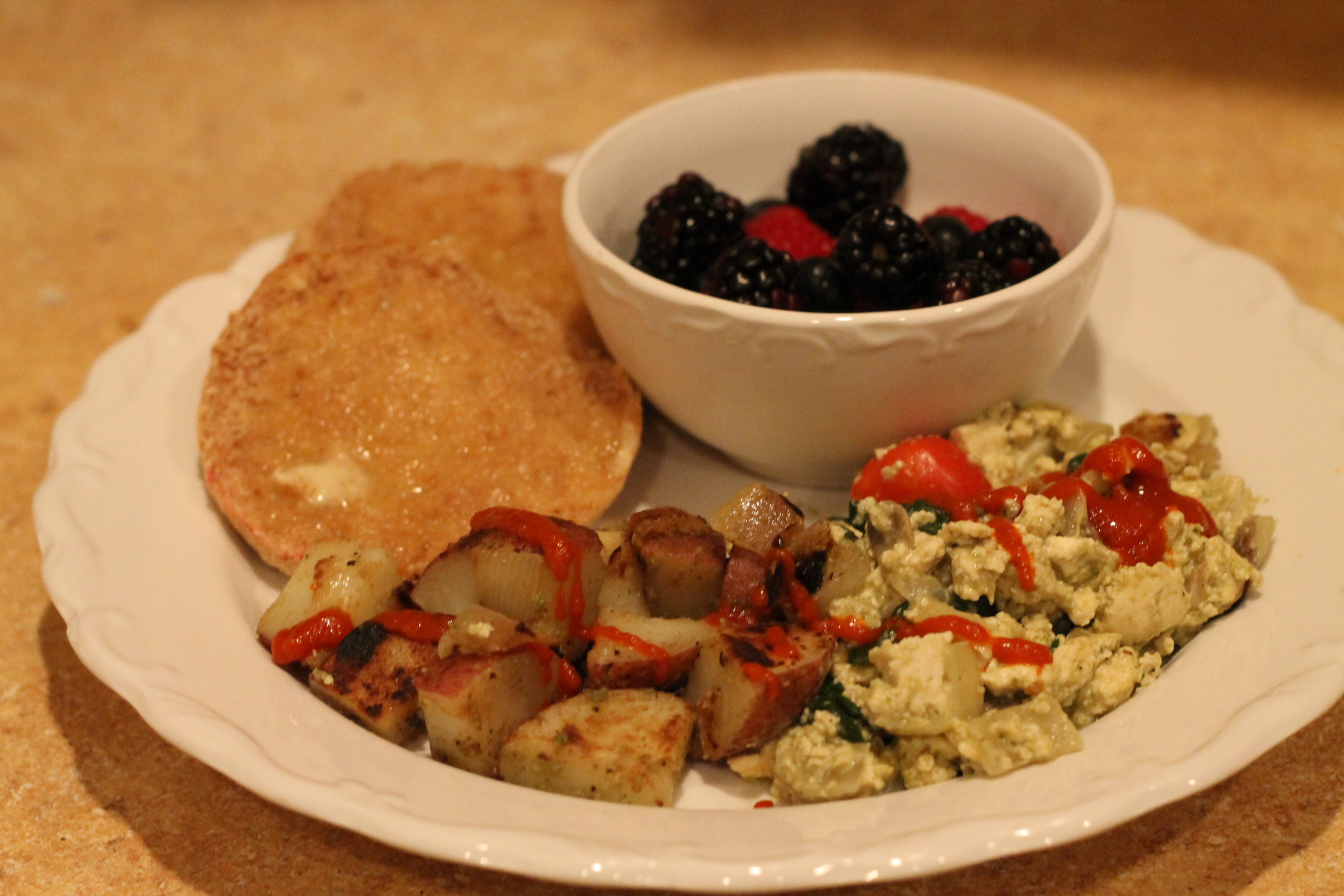Breakfast: Berries, English Muffin, Hash Browns, Veggie-Pesto Tofu Scramble